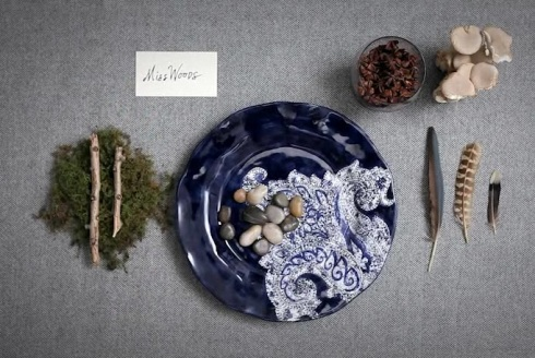 entertaining naturally table setting with rocks feathers etc