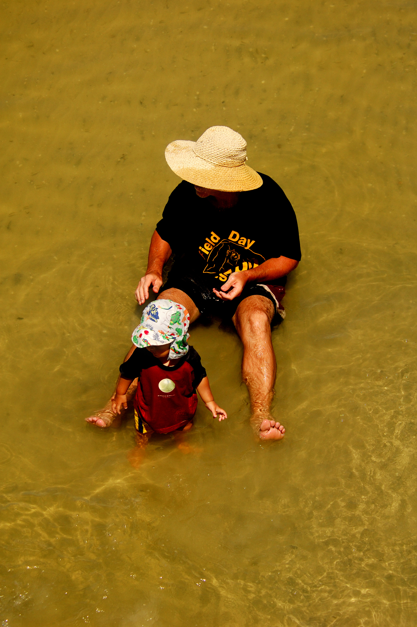 natural pappa and son in the water