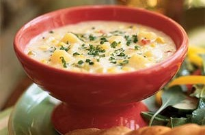 homemade corn chowder recipe with bread and greens