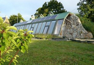 earthship exterior with stone sides
