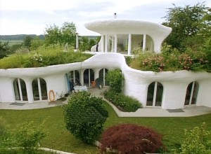 earthship mansion with white exterior