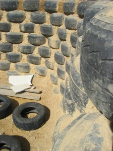 earthship rammed earth tire interior wall close up