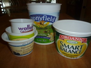 repurposed yogurt and butter containerts for seed pots