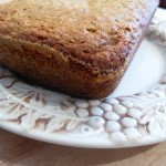 vegan banana bread loaf on white plate